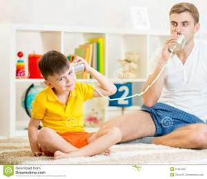 child-father-having-phone-call-tin-cans-plays-57455452